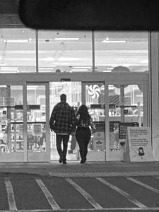 Couple walking into a store